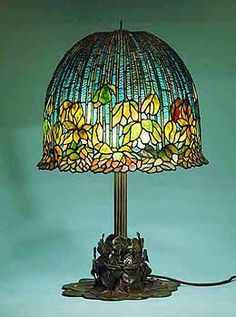Flowering Lotus Tiffany lamp w/great detail in its base.