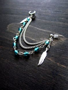 Turquoise beaded feather ear cuff, ear cuff earring, feather jewelry. $17.50, via Etsy.