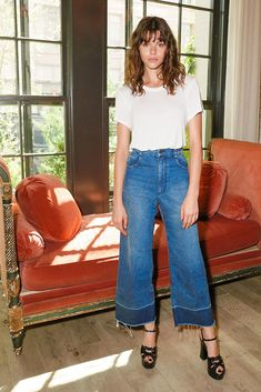 Georgia Fowler looking mighty fine in frayed hem flared denim jeans, strappy leather platform sandals and a classic white tee at W Magazine's IT Girls party at the Howard Hotel in New York