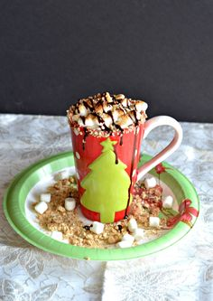 S'mores Hot Chocolate takes hot cocoa to a new level with graham cracker crumbs, toasted marshmallows, and chocolate syrup