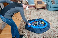 Lego mat - cinches up to a bag. Genius...no stepping on leftover legos!
