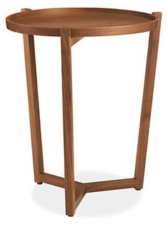 The Jax end table features a tray-style top carved from a solid panel of wood, while beautiful joinery at the center of the elegant base speaks to the solid craftsmanship of the Vermont woodworkers who build it. The table's open, airy design is made sturdy with mortise-and-tenon construction that ensures lasting quality.