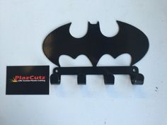 BATMAN Key Holder Key Rack CNC Plasma cut & powder coated with choice of colours. CNC Plasma cut from Mild Steel. Batman Begins. Other colour Powder Coatings are available if required. Batman Metal, Plasma Cutter Art, Key Rack, Plasma Cutting, Key Hooks, Metal Crafts, Powder Coating, Metal Signs, Metal Art