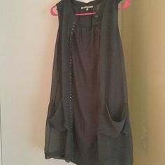 Lrg sleeveless top from collective concepts From collective concepts large statement piece works great with black leggings great material. Gently used Collective Concepts Tops Blouses