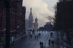 <p>People walk to Red Square shrouded in cold mist, with the St. Basil's Cathedral, center, and Lenin mausoleum, right, in Moscow, Monday, Jan. 9, 2017. The temperature plunged to minus -21 Celsius (minus-6 F). (AP Photo/Alexander Zemlianichenko) </p>