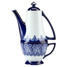 Nesting Art Deco-style porcelain teapot and teacup in hand-painted blue and white with classic ornamentation.   Product: Teapot ...