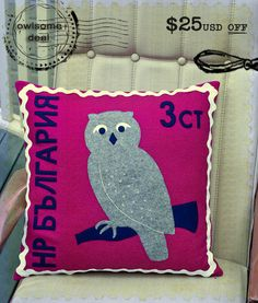 Australia's Touch Wood Design is crossing the globe with a series of limited edition felt cushions inspired by vintage postage stamps – including this lovable Bulgarian owl stamp in fuschia, grey marle, navy and white.