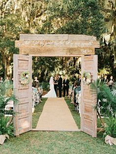 Love this rustic make shift doors for outdoor wedding just change the saying on it