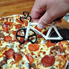 A TOUR de PIZZA slicer that we would all be better off owning.