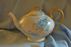Antique Limoges France T&V Blue Floral Handpainted Porcelain Teapot. The bottom is signed by the artist. This teapot is in excellent condition without any chips, cracks or crazing. There is not any s