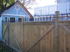 Wood Fence with Fort York Ornamental Topper