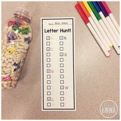 FREE Letter Hunt Printable: Place letter beads in a bottle with some beans and have the students find and trace/check off the letters.  Great literacy center or guided literacy activity for reinforcing letter names in Kindergarten! {A Pinch of Kinder}