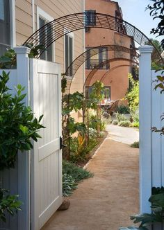 ... - arbor walkway - rebar arch - dg pathways - garden gate - side yard