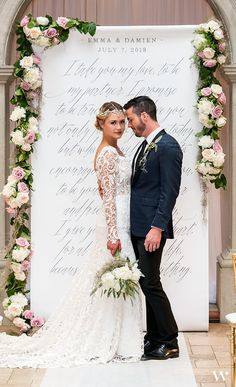 This Modern Fairy Tale Personalized Backdrop featured in this bride and groom shot displays gracious fonts with old world elegance, giving an exquisite look that is luxurious with a hint of modern flair. Display at your ceremony, welcome area, sweet bar, drink station or anywhere else throughout your decor that could use a little love.