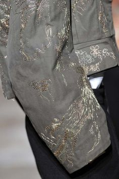 Jacket sleeve detail with minimal gold hand embroidery; drawing with stitch; close up fashion // Dries Van Noten. Couture.  Fall 2012