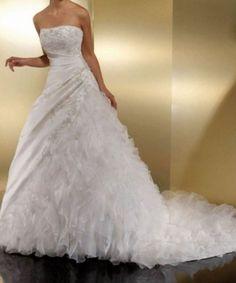 robe de mariée argentan d'occasion Empire du Mariage - Seine et Marne