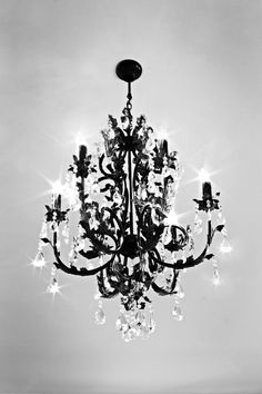 Maybe not black, but love the idea of some chandeliers as decor