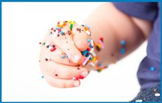 Dip hand in water and then in sprinkles - photograph the baby trying to eat the sprinkles off!