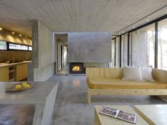 Bak architecture, polished concrete interior with pine bench
