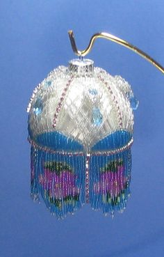 """another little """"lampshade"""" Beaded ornament cover pattern via Etsy."""