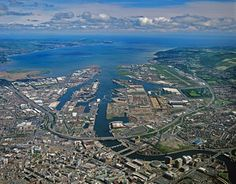 Belfast, County Antrim, Northern Ireland - a view of modern Belfast from high above. Back in 1729 on the of June, my GGM, Elizabeth Stewart was born in Belfast. Both my Stewart lines are Ulster Scots. Belfast Northern Ireland, Dere, Holiday Places, British Isles, Aerial View, Homeland, Great Britain, Places To Visit, Belfast Harbour