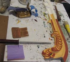 Traditional Water Gilding- The red parts are ready for the gilding