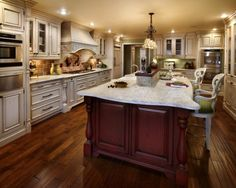 Riveting Large Kitchen Island with Seating and Storage also Decorative Wood Range Hood Covers with Classic White Paint Color also River White Granite Countertops from Kitchen Island Plans