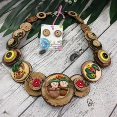 "Inspired by the May Gibbs classic ""Snugglepot and Cuddlepie"" this Gumnut Babies necklace is uniquely handmade by Addicted to Buttons with just the right amount of quirk! ~*~ #handmadejewellery #handcraftedjewellery #wood #buttonnecklace #snugglepotandcuddlepie #maygibbs #addictedtobuttons #buttonjewellery #handmadenecklace #woodenjewellery #handcraftednecklace #buttons #handmadeau #handmadeinaustralia #madeitau #handmadelife Baby Necklace, Button Necklace, Handmade Necklaces, Handcrafted Jewelry, Handmade Items, Australia Day, Wire Weaving, Wooden Jewelry, Happy Shopping"