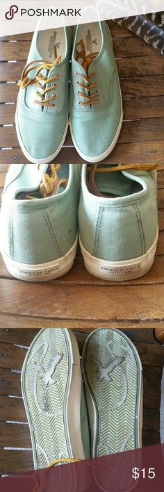 American Eagle shoes size 9 Perfect for Spring!  Cream and light greenish in color with leather laces.  In good condition with some wear. Laces are in perfect shape.  I love these just never wear them anymore. Looks cute with skinny jeans and shorts! Good casual shoes for everyday wear. American Eagle Outfitters Shoes Sneakers