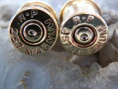 357 Magnum plugs, designer made them out of spent shells SICK, but there only one size between 0/00g :(