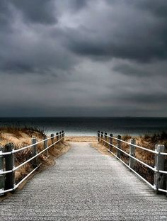 I love the look of this stormy sky over the beach and the possibility of a thunder storm.                                     Tumblr
