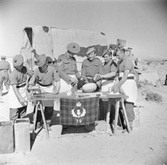 The Regimental Sergeant Major and other members of the 5th Cameron Highlanders preparing Christmas puddings in the Western Desert, 28 December 1942