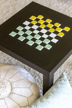 Make game night extra fun with this DIY checkerboard table (it works for chess, too!)