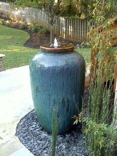 Olive shape jar makes great fountain for your backyard. The soothing sound of water will be very welcoming during a hot summer day. We have it all at AW Pottery. Olive shape jar makes great fountain f Backyard Water Fountains, Backyard Water Feature, Garden Fountains, Outdoor Fountains, Backyard Waterfalls, Garden Ponds, Koi Ponds, Backyard Ponds, Patio Fountain
