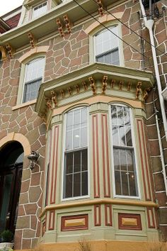 Exterior view. Such beautiful details in the bay window