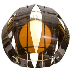 A Smoked Acrylic and Chrome Hanging Pendant | From a unique collection of antique and modern chandeliers and pendants  at https://www.1stdibs.com/furniture/lighting/chandeliers-pendant-lights/