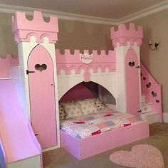 princess castle bed with slide, play area/other bed above, wardrobes and drawers in stairs.