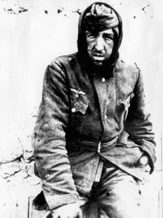 The misery of Eastern Front: This German POW, barely dressed for the subzero temperatures, looks at the lens of the Red Army photographer with an expression of utter exhaustion and despair. Few German POWs survived Russian captivity -- which often included a dispatch to Siberia.