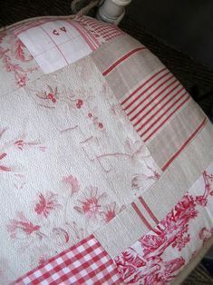 A chair cushion upholstered in an antique linen patchwork. Wonder if I could do this to replace the missing cushion on the small wooden rocking chair of my great grandmother's?