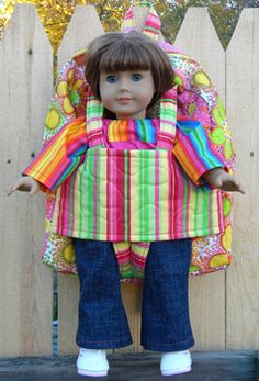 "Pattern includes doll carrier backpack for 18"" dolls, one for smaller dolls, and a backpack with a zippered pocket on the front instead of the doll-carrying pocket."
