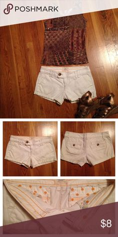 """American Eagle shorts Off white with cute polka dot detail on inside! Size 2, inseam approx 2-1/2"""", low rise , waist approx 15-1/2 when laying flat. American Eagle Outfitters Shorts Jean Shorts"""