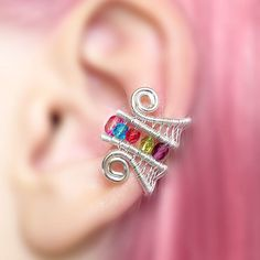 Rainbow EAR CUFF kawaii colorful pink blue green red purple glass crystals perfect for gift silver wire wrapping simple ear cuff fake piercing cute pastel goth pride jewelry   Elegant piece of jewel is made of silver plated copper wire and and features 5 czech glass crystals. The ends of the ear cuff are curved for comfortable wear and the design is elegant graceful and contemporary. No piercings are required to wear the cuff. Simply place over the top edge of your ear and slide it down into…
