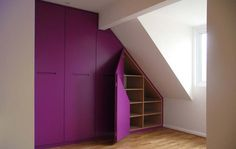 Purple lacquered fitted wardrobes with bespoke interiors and bi-fold doors.