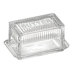 "$9.95  Glass Butter Dish. 6.62""Wx4""Dx3.25""H    Charming retro-inspired ribbed glass dish with starburst base and ""BUTTER"" embossing on the lid stores and serves a one-pound block of butter or a standard stick.    Clear glass  Dishwasher- and freezer-safe"