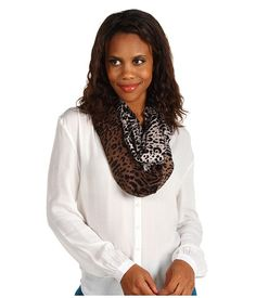 Calvin Klein Ditsey Leopard Infinity  Fierce, fun, and fabulous, that is who you are and that is exactly how your friends, colleagues, and even strangers will see you when you are wearing this bold scarf from Calvin Klein™