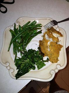 Baked Tilapia with brown rice breadcrumbs seasoned with fresh herbs and spices, boiled green beans with garlic & kale chips made with a little EVOO and garlic salt.