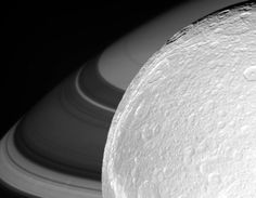 Approaching the moon Dione, with Saturn in the background, on October 11, 2005.