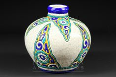 A Boch Freres, Belgium, squat ovoid vase, the pale grey crackle glaze ground decorated with yell...