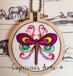 Pretty little fancy butterfly mini hoop necklace. Hand sewn on canvas in single thread and set in this super cute 5.5cm mini embroidery hoop.