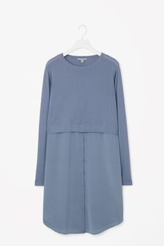 Designed for a contrast of textures, this knitted cotton dress has a lightweight silk skirt with a button detail along the front. A loose, relaxed fit, it has a ribbed round neckline, long sleeves and a softly curved hemline. Muslim Fashion, Modest Fashion, Fashion Outfits, Dress Fashion, Casual Hijab Outfit, Casual Outfits, Casual Dresses For Women, Clothes For Women, Hijab Stile